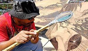 Kinh ngạc họa sĩ vẽ tranh bằng ánh nắng mặt trời