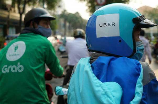 Có dấu hiệu phạm luật, Grab-Uber có thể bị phạt nặng
