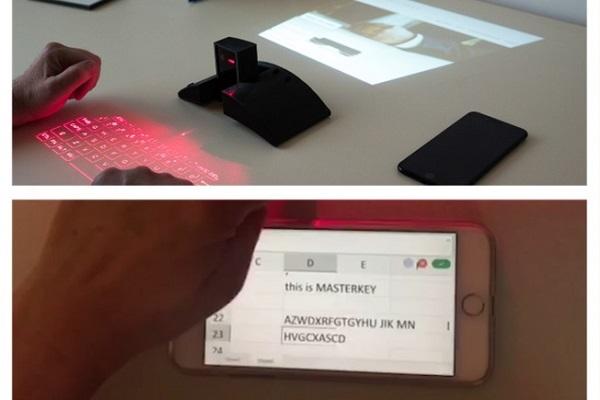 """Không bàn phím? Không vấn đề. Thiết bị này sẽ """"chiếu"""" một bàn phím ảo cho bạn gõ."""