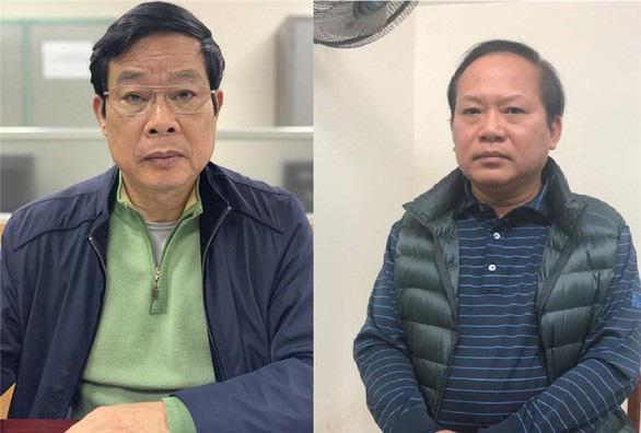 Bị can Nguyễn Bắc Son (trái) và bị can Trương Minh Tuấn - Ảnh: Bộ Công an