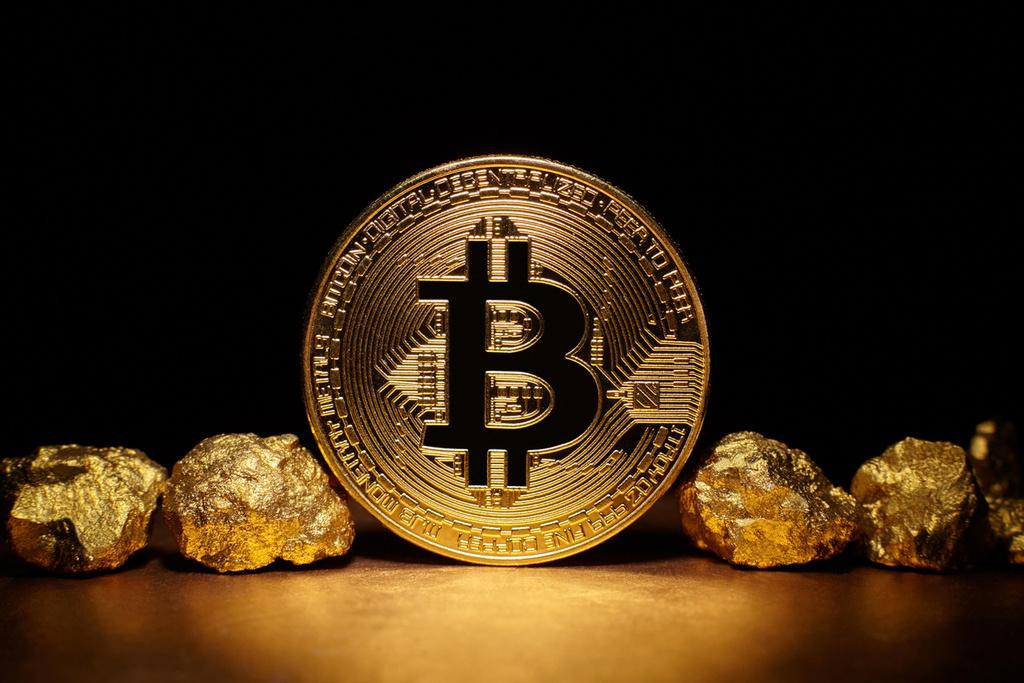Kỷ lục của giá vàng và Bitcoin trước thềm năm 2021