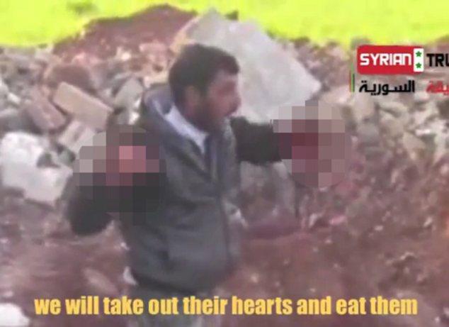 Video quân nổi dậy Syria ăn tim lính Syria gây sốc